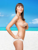 Beautiful topless woman on the beach — Stock Photo