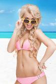 Beautiful woman in bikini with sunglasses — Stock Photo