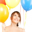 Happy girl with colorful balloons — Stock Photo #26001335
