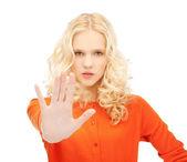 Girl making stop gesture — Stock Photo