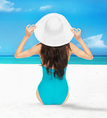 Model posing in swimsuit with hat — Stock Photo