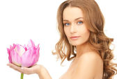 Lovely woman with lotos flower — Stock Photo