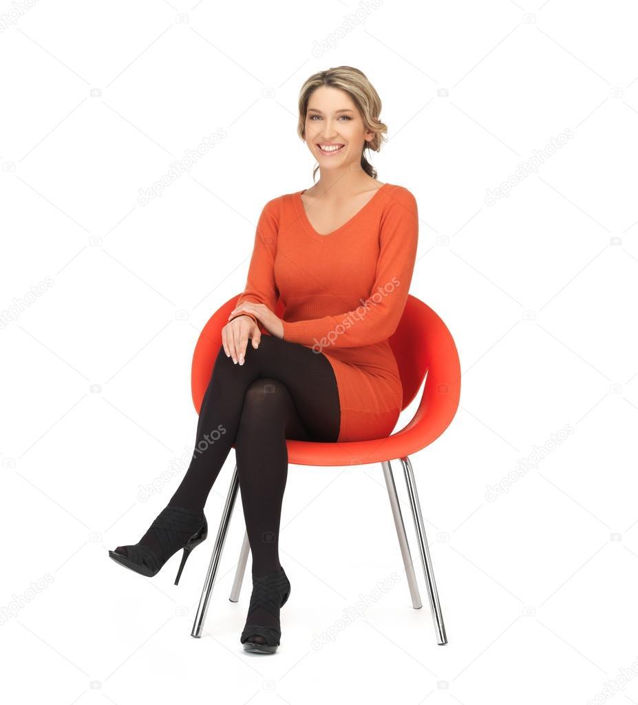 femme assise sur une chaise photographie syda productions 26001529. Black Bedroom Furniture Sets. Home Design Ideas