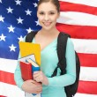 Student with books and schoolbag — Stock Photo #26146415