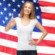 Teenage girl in blank white t-shirt with thumbs up — Foto Stock