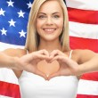 Woman showing heart shape — Stock Photo