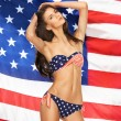 Model in bikini with american flag — Stock Photo