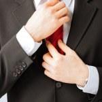 Man adjusting his tie — Stock Photo #26146549