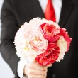 Man giving bouquet of flowers — Stock Photo #26146579