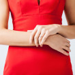 Woman showing wedding ring on her hand — Stock Photo #26146681