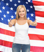 Teenage girl in blank white t-shirt with thumbs up — Stock Photo