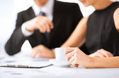 Woman hand signing contract paper — Stock Photo