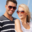 Happy young couple in port — Stock Photo #26262863