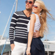 Happy young couple in port — Stock Photo #26262893