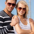 Happy young couple in port — Stock Photo #26262927