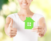 Woman hands holding green house — Stock Photo