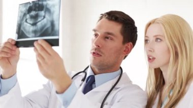 Closeup of two doctors with x-ray prints — Stock Video