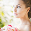 Bride with bouquet of flowers — Stock Photo #26367019
