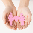 Womans hands with paper women — Stock Photo