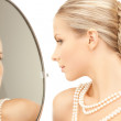 Woman with necklace from pearls — Stock Photo