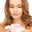 Woman with rose petals — Stock Photo #26368085