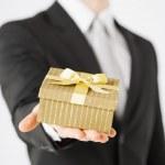 Man hands holding gift box — Stock Photo