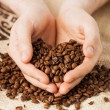 Man holding coffee beans - Stock Photo