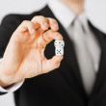 Mans hand holding white casino dice — Stock Photo