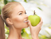 Woman smelling apple — Stockfoto
