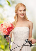 Country girl with bicycle and flowers — Stock Photo