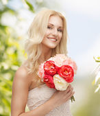 Woman with bouquet of flowers — Foto de Stock