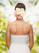 Woman with flowers in her head — Stockfoto