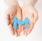 Man hands with paper men — Stock Photo
