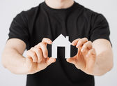 Man hands holding paper house — Stock Photo
