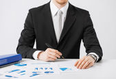 Businessman working and signing with papers — Stock Photo