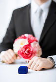 Man with gift box in suit — Stock Photo