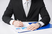Businessman working and signing papers — Stock Photo