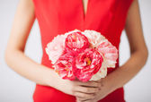 Woman hands with bouquet of flowers — Stock Photo
