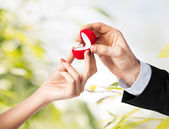 Couple with wedding ring and gift box — Stockfoto