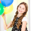 Happy girl with colorful balloons — Stock Photo #26628707