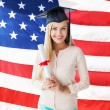 Student in graduation cap with certificate — Stock Photo