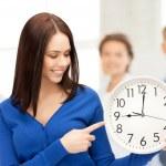 Woman holding big clock — Stock Photo #26681219