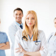 Female doctor in front of medical group — Stock Photo