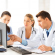 Team or group of doctors working — Stock Photo #26681897