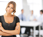 Attractive businesswoman in office — Stock Photo