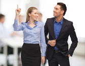 Man and woman pointing finger — Stock Photo