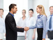 Man and woman shaking their hands — Stock Photo