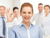 Young woman showing ok sign — Stock Photo
