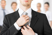 Man adjusting his tie — Stock Photo