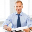 Businessman with notebook and calculator — Stock Photo